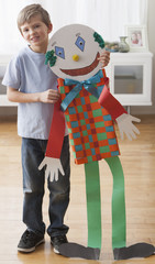 Caucasian boy smiling with puppet