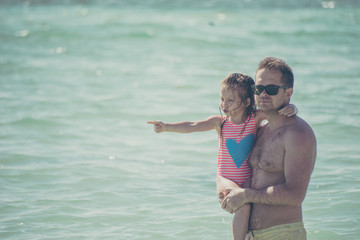 Father and daughter at the ocean