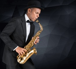 Sax. Black american jazz saxophone player. Vintage. Studio shot.