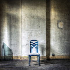 Lonely blue chair in a grungy interior