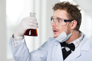 Test. Surprised crazy scientist with test tube