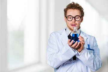 Scientist. Crazy chemist woman with disheveled hair and vial in
