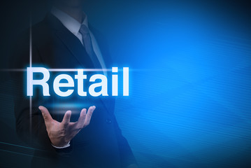 businessman with Retail word  on abstract background .