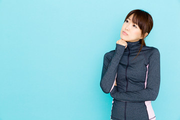 sporty asian woman on blue background