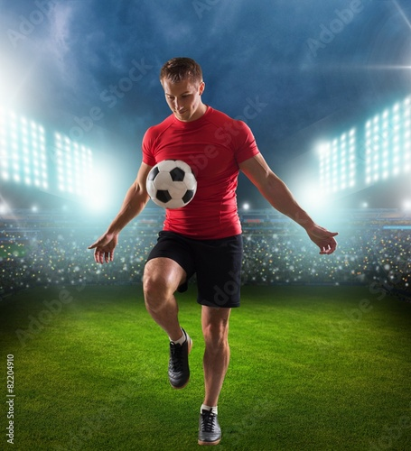 Soccer. One african man soccer player green jersey juggling in