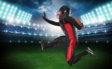 American Football. Football Player Running and Jumping with