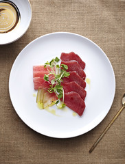 Plate of sliced meat and herbs