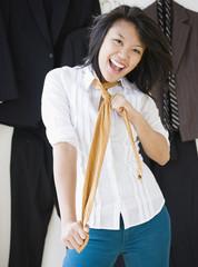 Asian woman wearing men's necktie