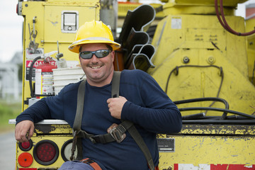 Caucasian worker smiling on truck
