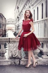 Lady in red in Venice, Italy