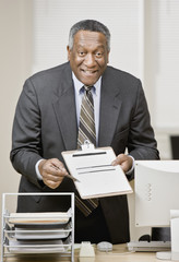 African businessman holding clipboard