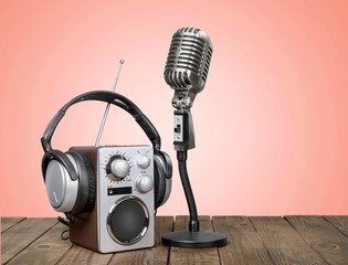 Wave. Retro radio, red microphone, headphones on table old style