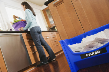 Mixed Race woman unpacking grocery bag
