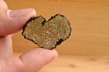 Heart shaped truffle in hand