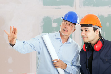 Architect explaining a work to the foreman