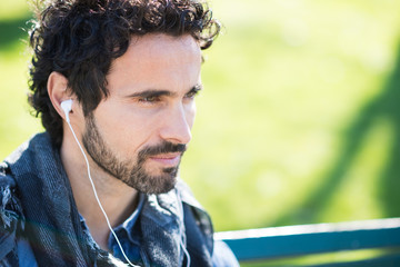 Man listening music outdoors