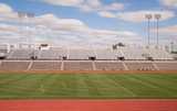 Fototapety College Level Track Stadium Puffy Clouds Blue Sky