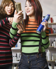 Multi-ethnic female hair stylists looking at hair product