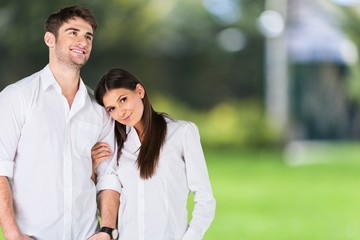 Home. Young couple standing on white background