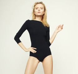 fashion model woman with perfect slim body and long legs