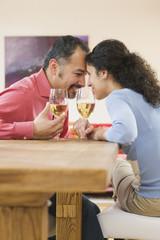 Hispanic couple touching foreheads