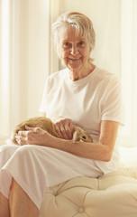 Older Caucasian woman petting rabbit