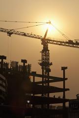Sun Shining Behind a Construction Crane
