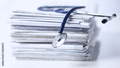 Medical stethoscope on the stack of paper - 82216175