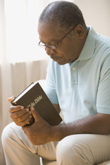 Senior African man holding bible
