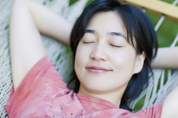 Asian woman sleeping in  hammock