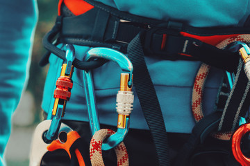 Close-up detail of rock climber wearing safety harness