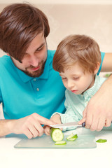 Father cooks with his son