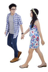 Attractive modern young couple in studio