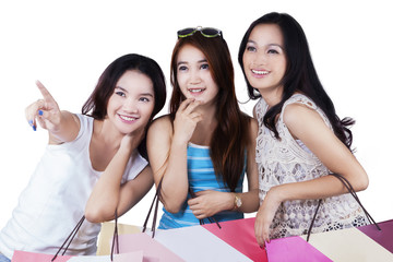 Beautiful teenage girls with shopping bags