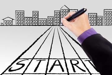 Businessman hand drawing a start line