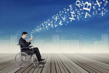 Businessman on wheelchair sending information