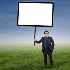 Businessman with empty copyspace at field