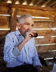 Senior man drinking plum brandy