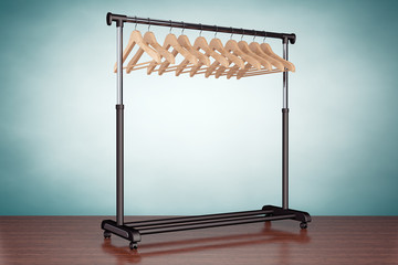 Old Style Photo. Mobile black coat rack with hangers