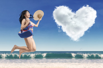 Carefree lady with a heart-shaped cloud