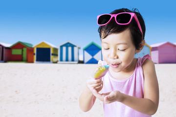 Child eats ice cream outdoors