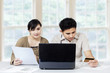 Couple paying bill online 1