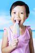 Cute girl licking ice cream