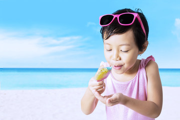 Cute child enjoy ice cream at shore
