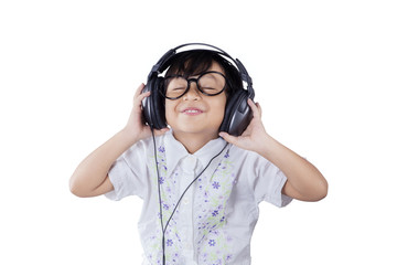 Cute little girl with headphones