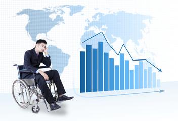 Depressed businessman sitting on wheelchair