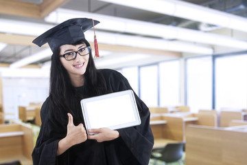 Female bachelor and digital tablet