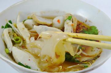 large noodle on chopstick