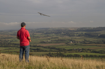 flying a model sailplane over English countryside
