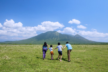 Happy family running to the mountain